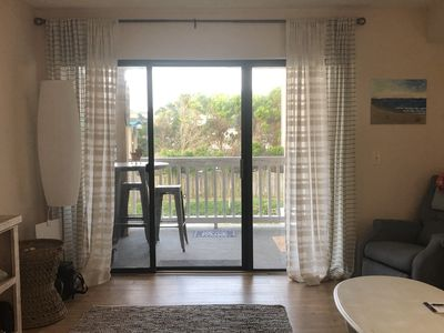 Photo for Pet friendly second floor condo less than a block from the beach!