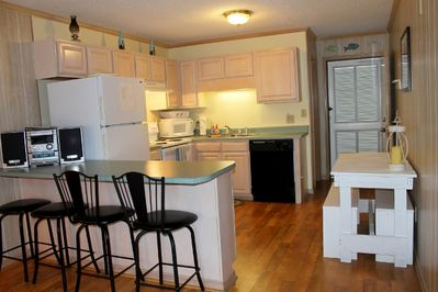 Kitchen that leads into living room