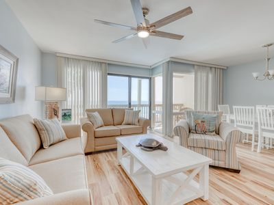 Photo for Beautiful beachfront condo with shared pool/hot tub and beach access!