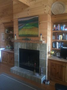 Wood burning fireplace with wet bar to the left.