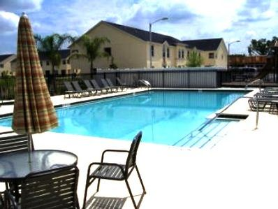 Relax Poolside... in Our Heated Pool with Lounge Chairs and Jacuzzi
