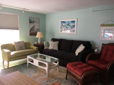 Comfortable living room with updated furniture and large flat screen tv