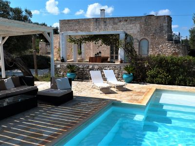 Photo for Stylish luxury trulli with private pool and amazing sea view