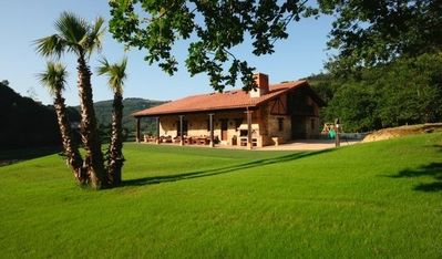 Photo for BEAUTIFUL COTTAGE BY THE RIVER, CLOSE TO BILBAO AND THE BEACH