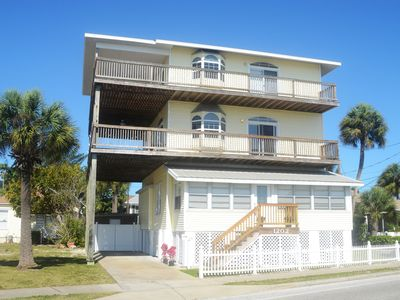 Photo for Beautiful beach house with private  dock one block from the beach sleeps 12