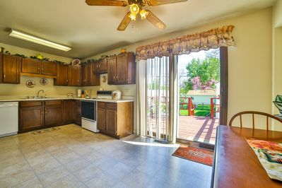 Kitchen area with view to the back deck and back yard