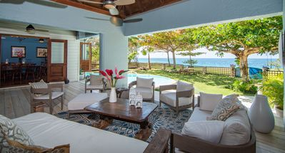 Back patio with beach entry infinity edge pool overlooking the Caribbean Sea