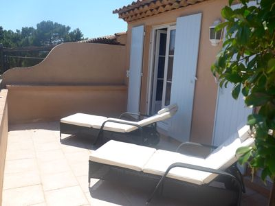 Sun drenched upper terrace, totally private. Lovely view of garden & golf course