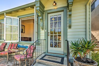 This vacation rental cottage has a lovely front porch patio.