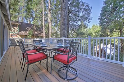 Enjoy spending your days lounging on the spacious deck with patio furniture and epic mountain and forest views.