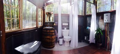 Enjoy unlimited hot water in the greenhouse bathroom