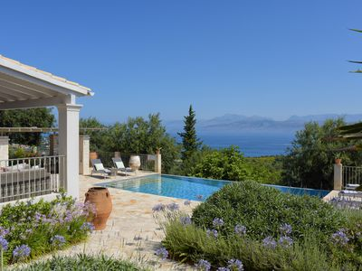 Photo for 3 bedroom house with stunning views minutes from Avlaki Beach.