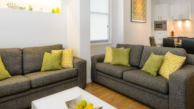 Photo for Inner-city apartment, 6 minute stroll to CBD with off-street car park