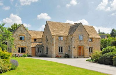 Photo for Tree Tops House is a grand, detached Cotswold stone house and a cottage annexe, in Temple Guiting