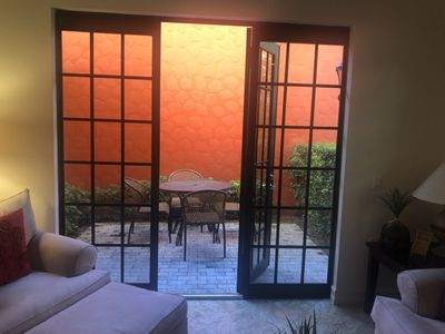 Sun setting on courtyard patio off of living room