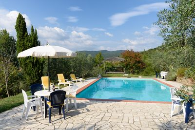 Poolside of Borgo's pool, with one of the two pergolas near pool