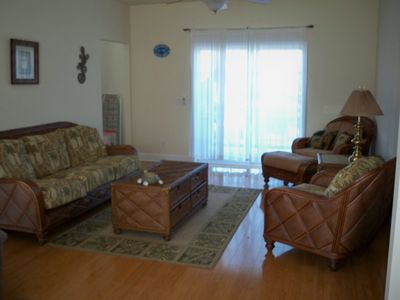 Beach decor in living room, additional sofa has a queen sleeper bed inside