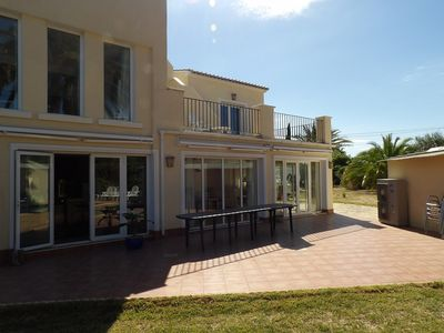 Photo for Exceptional 7 bedroom. Less than a 5 minute drive to the the blue flagged beach