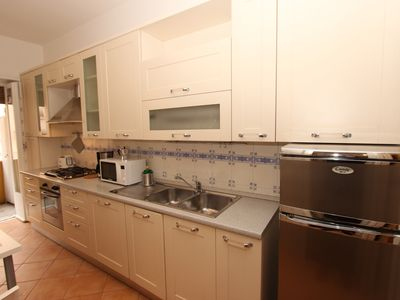Photo for A large and affordable 2 bedrooms apartment near Trastevere Station