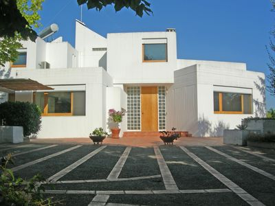 Photo for Refined modern architectural design villa in typical Apulian landscape.