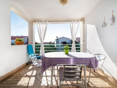 Photo for Two bedroom apartment with terrace and sea view Mandre, Pag (A-13015-b)
