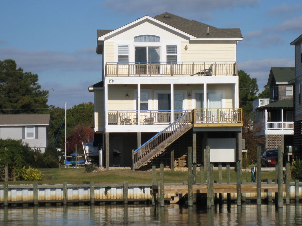 Beautiful waterfront home features private dock use for Wood piling foundation cost