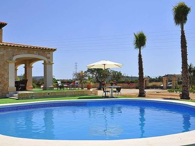 Photo for BOUGANVILLE RESORT- Chalet with private pool Llucmajor. 5 bedrooms Satellite TV. BBQ - Free Wifi