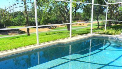 Photo for Southern Dunes 4/3 Pool Home with TWO master ensuites. Oversized pool deck with golf course views! (