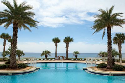 En Soleil seasonal heated swimming pool provides gorgeous views of ocean