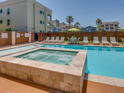 Photo for Stately condo w/ shared pool, hot tub, BBQ, walking distance to beach - dogs OK!