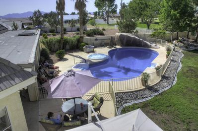 View of the pool and spa area from the game room balcony!