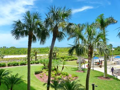 Photo for Relaxing beachfront condo w/ heated pool in a tropical garden setting