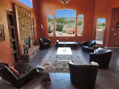 Desert and mountain views from living room + double height ceilings & fireplace