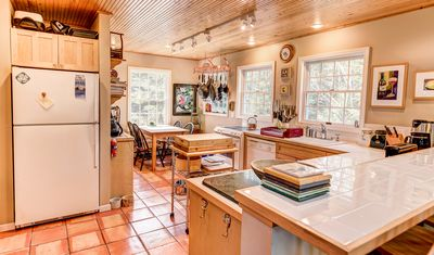 Tiled counters, dishwasher, oven , all the kitchen utensils for a gourmet feast