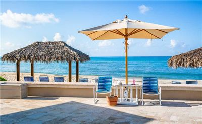 Bright and Cheery Oceanfront Condo with Panoramic Views of the Caribbean Sea