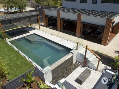 Photo for St Tropez - Amazing resort style backyard pool, spa and sunken lounge with gas fire!