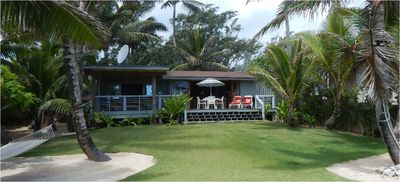 The Beach House in a beautiful garden of  dozens of palms and white beach sand