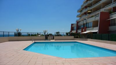 Photo for 3 rooms facing the sea with pool and private closed box