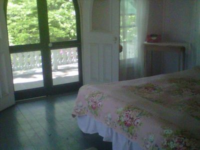 Two upstairs bedrooms have their own porches