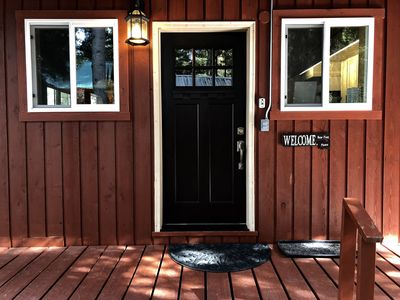 Side porch  of main cabin welcomes you.