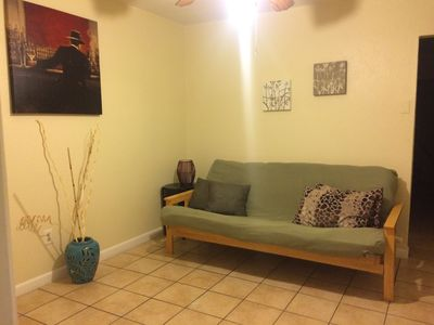 Living room with full size futon.
