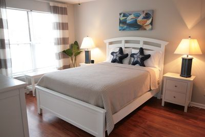 The master suite has a queen bed and opens to the covered porch.