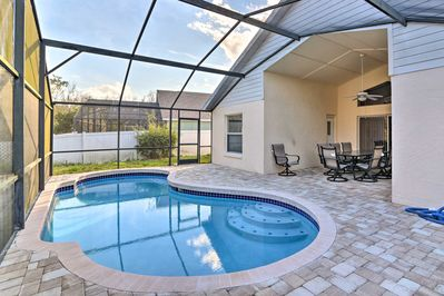 The home boasts a private lanai, heated pool, and sleeping arrangements for 14!