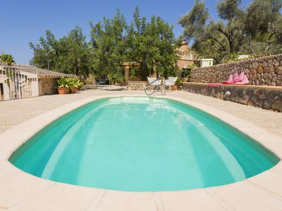 Photo for This 3-bedroom villa for up to 6 guests is located in Urbanització de la Torre Picada and has a priv