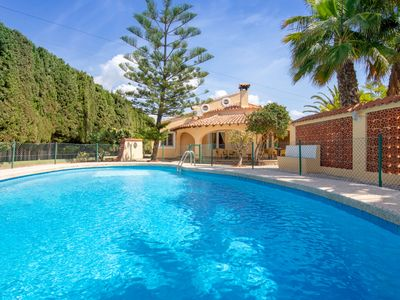 Photo for This 6-bedroom villa for up to 12 guests is located in Calpe and has a private swimming pool and air