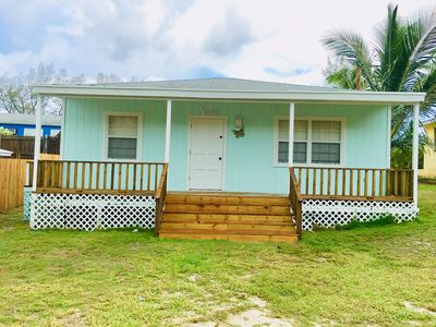 COZY SEASIDE 2 BED/2 BATH BIMINI COTTAGE-BAY SIDE VIEW -soft green colored house