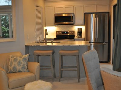 Modern, well equipped kitchen w walk out patio and great room.