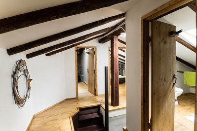 Attic landing with hand crafted doors, 200 years old exposed beams.