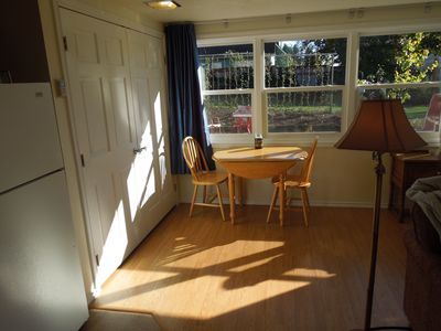 Dining area - table opens to accommodate 4.  Full Murphy bed behind double doors