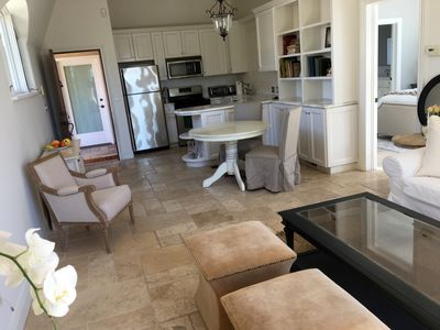 Main living area/kitchen w/marble counters. Laundry located just out the door